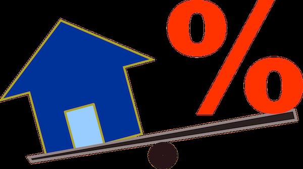 Balanza con la tasa de interés para crédito hipotecario